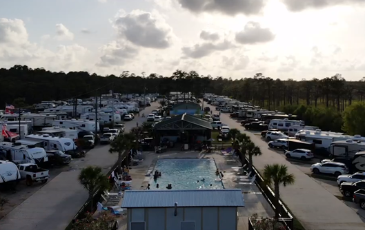 An RV park with a pool in the center