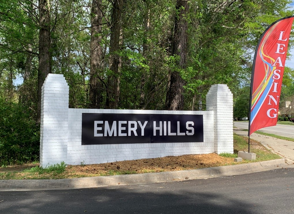 White brick entrance sign for Emery Hills
